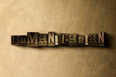 HUMANITARIAN - close-up of grungy vintage typeset word on metal backdrop Royalty Free Stock Image