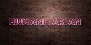 HUMANITARIAN - fluorescent Neon tube Sign on brickwork - Front view - 3D rendered royalty free stock picture. Can be used for online banner ads and direct Stock Photo