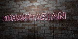 HUMANITARIAN - Glowing Neon Sign on stonework wall - 3D rendered royalty free stock illustration. Can be used for online banner ads and direct mailers Royalty Free Stock Photography