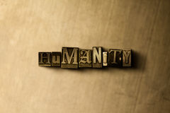 HUMANITY - close-up of grungy vintage typeset word on metal backdrop. Royalty free stock - 3D rendered stock image.  Can be used for online banner ads and Stock Photos