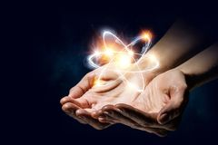 Humankind and science. Human hand and atom molecule as science concept. 3d rendering Royalty Free Stock Images
