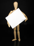 Humanoid doll with black background and white sign Stock Photos