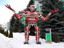 The humanoid metal funny robot the autoboat Red, is made of car spare parts, refuels gasoline, parts of body of the robot, royalty free stock image