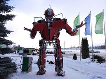 The humanoid metal funny robot the autoboat Red, is made of car spare parts, refuels gasoline, parts of body of the robot, stock images