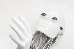 Humanoid robot head with hand closeup Stock Images