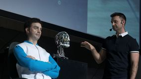 Humanoid robot man on stage. Innovative development in robotics and artificial intelligence. Android Presentation