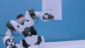 Humanoid robot moving hands and walking around at future exhibition. Humanoid robot moving hands and walking around at technology show. Future and robotics stock video