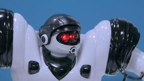 Humanoid robot moving hands and walking around at future exhibition. Humanoid robot moving hands and walking around at technology show. Future and robotics stock video footage