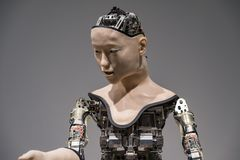 Humanoid robot performing show in Miraikan National Museum of Emerging Science and Innovation. TOKYO, JAPAN - 21 FEB 2018: Humanoid robot performing show in stock photo