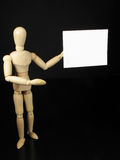 Humanoidpuppe mit weißem Zeichen, dünn zu schreiben stockfotografie