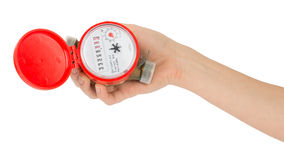 Humans arm holding water meter Stock Photos