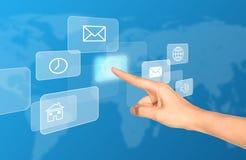Humans arm touching virtual screen Stock Photos