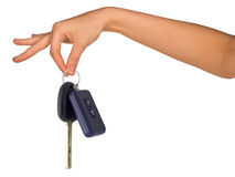 Humans hand holding car keys. On isolated white background Stock Image