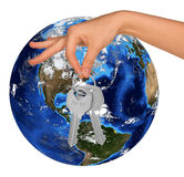 Humans hand holding keys and Earth Royalty Free Stock Photo