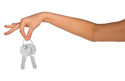 Humans hand holding keys. On isolated white background Stock Photos
