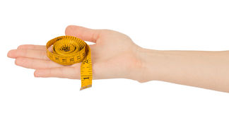 Humans hand holding tape measure Stock Photo