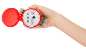 Humans hand holding water meter. On isolated white background Royalty Free Stock Photography