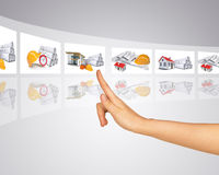 Humans hand with holographic tape. With pictures on abstract background Stock Photos