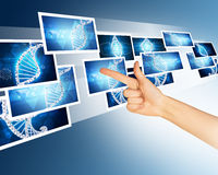 Humans hand pointing blue holographic pictures Stock Photography