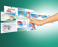 Humans hand touching holographic photos. On abstract background Royalty Free Stock Images