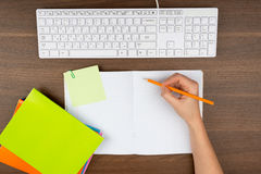 Humans hand writing in copy book Stock Images