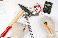 Humans hands in gloves with calculator Royalty Free Stock Photo