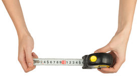 Humans hands holding tape measure Stock Photography