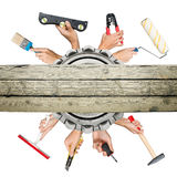 Humans hands holding tools Royalty Free Stock Photo
