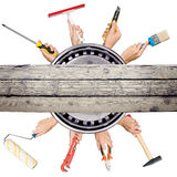 Humans hands holding tools on white background Royalty Free Stock Photography