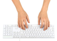 Humans hands using keyboard. On isolated white background Royalty Free Stock Photography