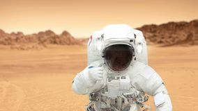 Humans on the planet Mars. Astronaut on Mars shows a thumbs-up royalty free stock photography