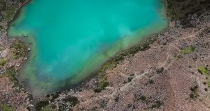 Humantay lake in Peru on Salcantay mountain in the Andes at 5473m altitude, aerial video stock footage