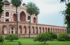 Humayun`s Tomb Side view behind trees royalty free stock images