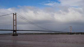 Humber Bridge, suspension bridge, viewed from Barton-on-Humber, Lincolnshire looking back towards Hessle, Yorkshire. Humber Bridge, a single span suspension stock image