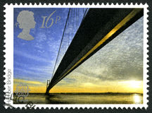 Humber Bridge UK Postage Stamp. GREAT BRITAIN - CIRCA 1983: A used postage stamp from the UK, depicting an image of the Humber Bridge in England, circa 1983 stock photo