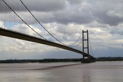 Humber bridge. What used to be the longest single span suspension bridge in the world reaches from Hessle to Barton across the murky waters of the river Humber Royalty Free Stock Photo