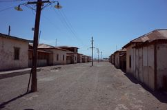 Humberstone Saltpeter Worksm in northern Chile. An eerie street in the abandoned Humberstone saltpeter works. This abandoned nitrate town was extremely important royalty free stock photo