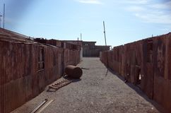 Humberstone Saltpeter Worksm in northern Chile. An eerie street in the abandoned Humberstone saltpeter works. This abandoned nitrate town was extremely important royalty free stock images