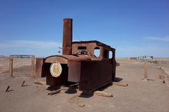 Humberstone Saltpeter Worksm in northern Chile. The remains of a train in the abandoned Humberstone saltpeter works. This abandoned nitrate town was extremely royalty free stock images
