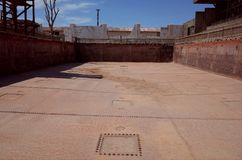 Humberstone Saltpeter Worksm in northern Chile. A rusted swimming pool in the Humberstone saltpeter works in northern Chile stock photos
