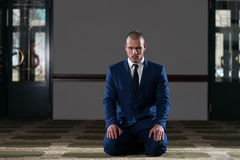 Humble Businessman Muslim Prayer In Mosque Royalty Free Stock Photo