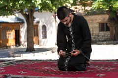 Humble Muslim In Dishdasha Prayer Royalty Free Stock Photo