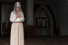 Humble Muslim Prayer Woman. Young Muslim Woman Praying In Mosque Stock Photos