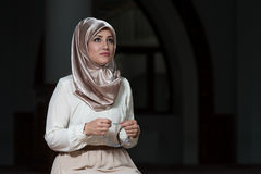 Humble Muslim Prayer Woman. Young Muslim Woman Praying In Mosque Royalty Free Stock Image
