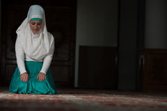 Humble Muslim Prayer Woman. Young Muslim Woman Praying In Mosque Stock Images