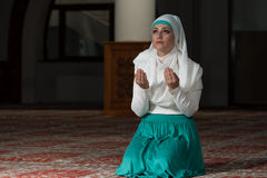 Humble Muslim Prayer Woman. Young Muslim Woman Praying In Mosque Stock Photo