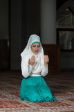 Humble Muslim Prayer Woman. Young Muslim Woman Praying In Mosque Royalty Free Stock Photo