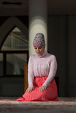 Humble Muslim Prayer Woman. Young Muslim Woman Praying In Mosque Stock Photography