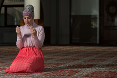 Humble Muslim Prayer Woman. Young Muslim Woman Praying In Mosque Stock Image