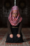 Humble Muslim Prayer Woman. Young Muslim Woman Praying In Mosque Royalty Free Stock Photos